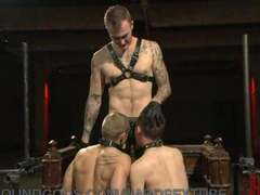 Two slave boys are made to please and serve Christian Wildes rock hard cock. They end up being suspended from the ceiling and used as fuck puppets as their asses get pounded.